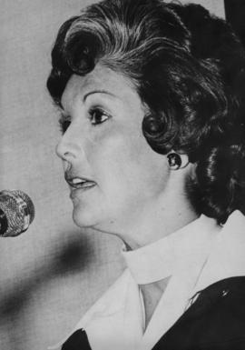 Iona Campagnolo speaking into microphone