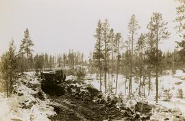 [Military vehicles traversing rough ground between Anahim Lake and Bella Coola]