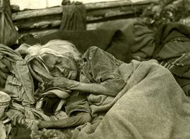 Elder Tsimshian woman sleeping under blanket