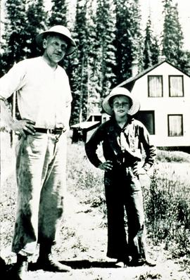 H.C. Kinghorn and young Jim Kinghorn in front of the boarded-up research residence at Aleza Lake