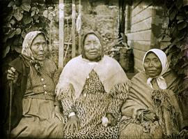 Close view of Elders sitting on porch at mission house in Kincolith, BC