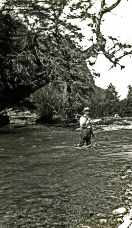 W.E. Collison standing in river at Kincolith, BC