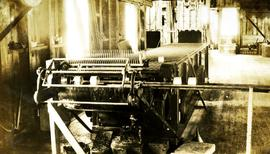 Lacquer machine in operation at cannery