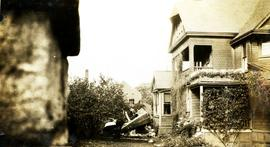 Wreck of an airmail plane near a house