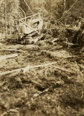Bulldozer clearing land for road making north of Stuart Lake
