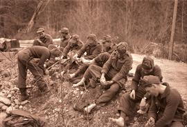 [Group of soldiers caring for their feet]