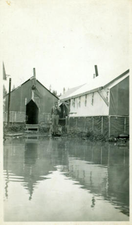 Man in Flooded Railway Camp