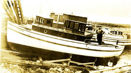 H. Welda standing in his boat Coaster in dry dock at Arrandale, BC
