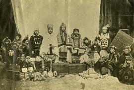 Tsimshian chiefs and families posing with goods from potlatch