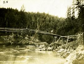 Log pole bridge accross canyon in Nass River, BC