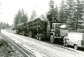 Fully loaded logging truck with two trailers