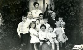 Marion and W.H. Collison posing with grandchildren at Kincolith, BC