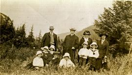 W.H. Collison posing with children and grandchildren in meadow at Kincolith, BC