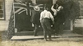"Four men displaying a ""Union Jack"" flag"
