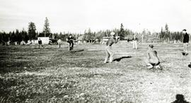Young Men's Forestry Training Program (YMFTP) crew playing baseball at Aleza Lake village