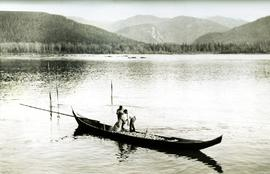 Two men in canoe: Oolichan fishin on Nass River, BC
