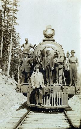 Railway workers on Pacific Great Eastern #52 locomotive
