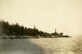 Lighthouse and rocky shore near Vancouver Island