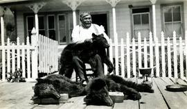 Nisga Chief Albert Allen with bear skins at Kincolith, BC