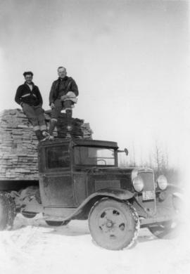 Men standing on loaded lumber truck at Peden Hill sawmill