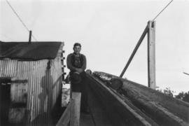 Young man by Peden Hill sawmill jackladder