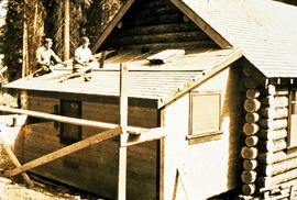 Percy Barr and wife Kathryn Reade Barr (nee Bradshaw) shingling lean-to addition to Aleza Lake lo...