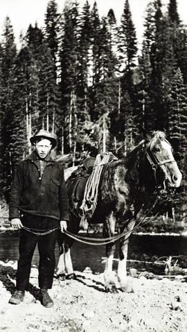 Bob St. Claire and his horse Nellie at Timber Berth 80, Bull River, B.C.