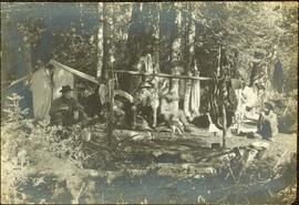 Crew Seated in Camp