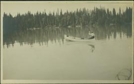Man Paddling Canoe on River