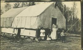 Houghtaling Family by Tent Building