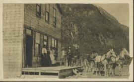Group of People and Horse and wagon in front of building