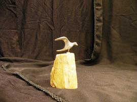 Pewter gull figure mounted on stone