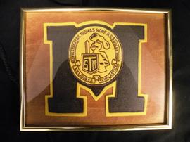 St. Thomas More High School varsity letter in frame