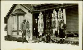 Ron Stewart, H.F. Glassey, & Unknown Man with Wolf Pelts