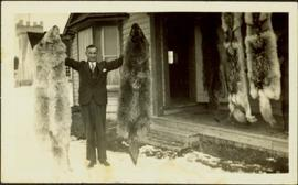 H.F. Glassey with Wolf Pelts