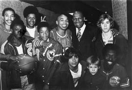 Members of the Harlem Globetrotters basketball team and school children
