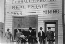Men in front of Terrace Land Co. building