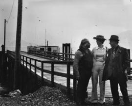 Iona Campagnolo with men in front of Skeena wharf