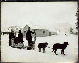 Man & Women with Dogsled Team