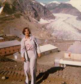 Iona Campagnolo standing in front of Granduc mining operation and glacier