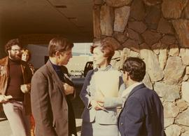 Iona Campagnolo talking to men possibly at the Kamloops Liberal Convention at the Stockmen's Hotel