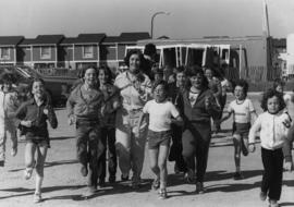 Iona Campagnolo jogging with group of Hilldale Public School students in Brampton