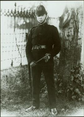 An member of the Royal Irish Constabulary poses for a photo