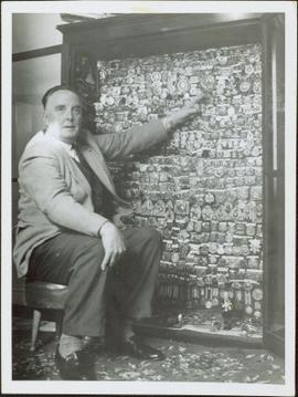 James Joseph Claxton posing with his collection of R.I.C. badges