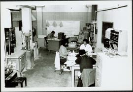 1965 - Clark & Cario Working with Others in Lab