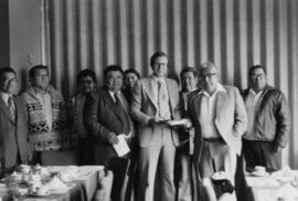 Group shot of Hugh Faulkner and Kitamaat Band Council at a land claims presentation