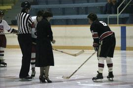 Iona Campagnolo holds hockey puck for face off for game in Kitimat arena