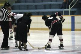 Iona Campagnolo drops hockey puck for face off for game in Kitimat arena