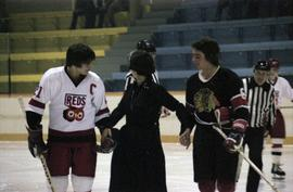 Hockey players supporting Iona Campagnolo on the ice in Kitimat arena