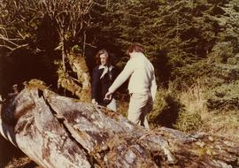 Iona Campagnolo looking at a fallen totem pole with Peter Jones
